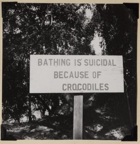 A sign near a beach on the Zambezi River in Africa, 1957.