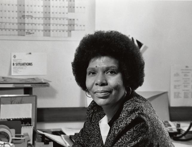 Black and white photograph of woman smiling.