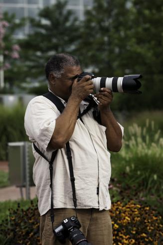 Man standing take a photograph.