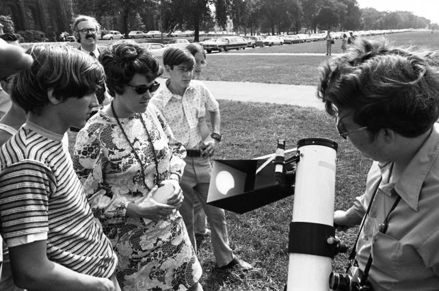 A demonstration of how to safely watch an eclipse, July 1972.