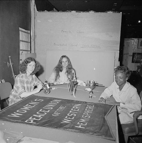 Three student volunteers, Deborah Ritter, Eleanor Wright and Diane Pryor, putting the finishing touches on objects in the We the People exhibition at what is now the National Museum of American History, 1975.