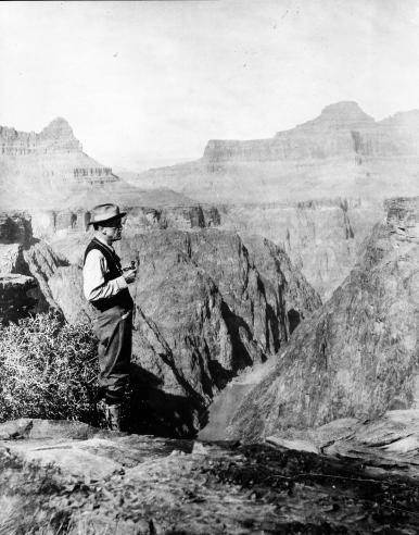 Smithsonian Secretary Charles D. Walcott viewing in the Grand Canyon, 1915.