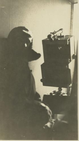 Astronomer Chester Burleigh Watts with altazimuth camera.