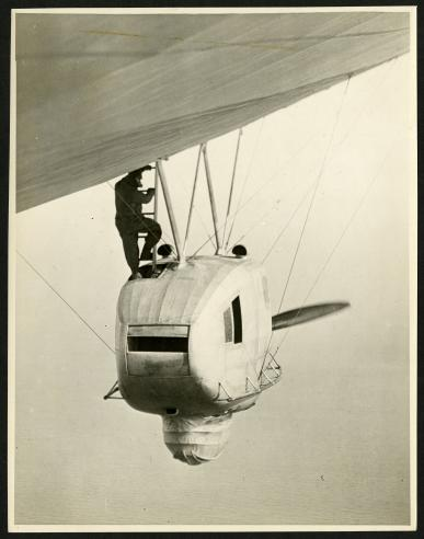 Photographer Walter Leroy Richardson heading into the observation basket of the dirigible.