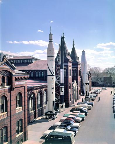 """Rocket Row"" along the west side of the Arts and Industries Building before the National Air and Space Museum was built, 1959. Accession 11-009, Smithsonian Institution Archives, Neg. no. 73-7185."