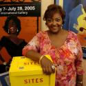 Torres-Carmona leans on a yellow box that reads: SITES.